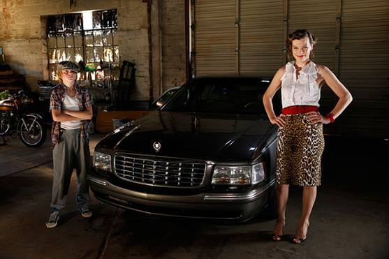 Spencer List as Bobby and Milla Jovovich as Olive in Bringing Up Bobby
