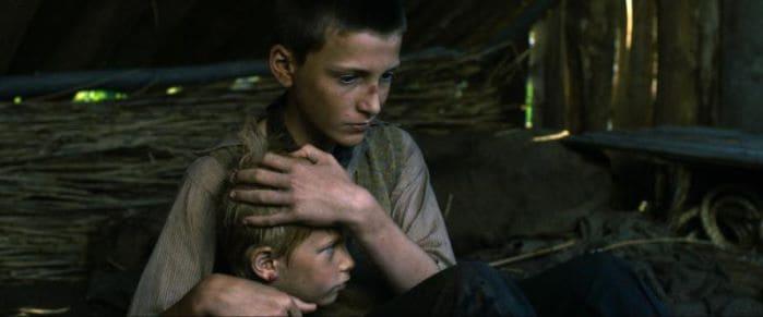 Hans (Levin Liam) calms a young boy