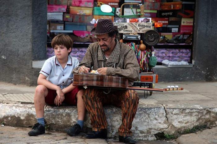 Zeze and a street musician