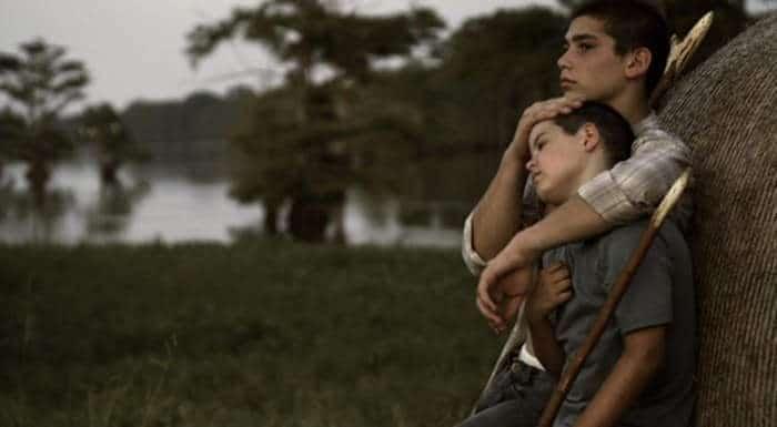Robbie Hendrick (William Ruffin) and his half-brother Fess Hendrick (John Alex Nunnery)