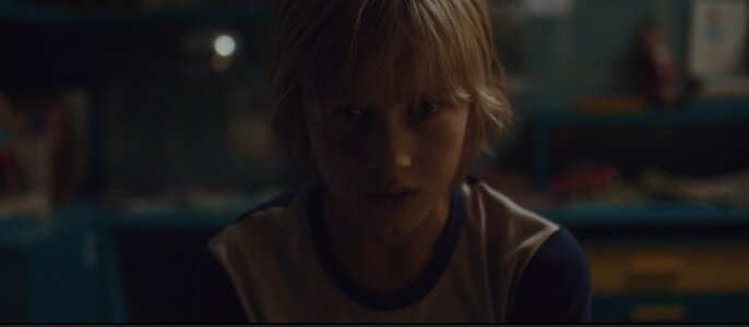 Valerio (Mattia Garaci) looking for answers – an eye-level shot implying a connection between the viewers and the young boy
